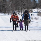 Isaac skiing with grandparents