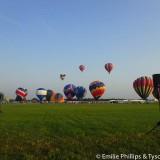 Hot air balloons lifting off