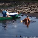 Other canoeists sinking in the mud