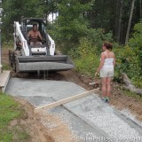 Leveling out the stone dust