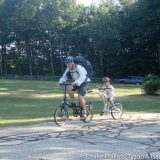 Tyson and Isaac bicycling together