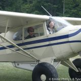 Emilie flying with Rene in his Super Cruiser
