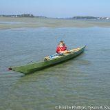 Isaac tipping grandma's (Trudy's) boat.